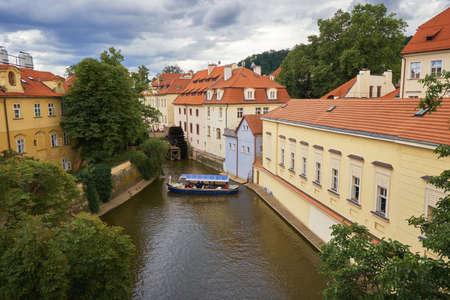 Vltava river water canal in Prague with boat European Czech republic