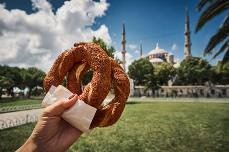 Simit Turkish bagel traditional culture street food bakery bread roll with sesame seeds pretzel