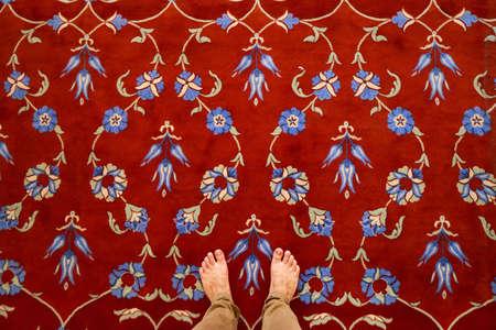 Red carpet  in Blue Mosque Sultanahmet interior beauty Turkish architecture Muslim landmark