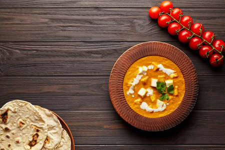 Shahi paneer traditional Indian vegetarian gravy meal with vegetables and butter paneer cheese