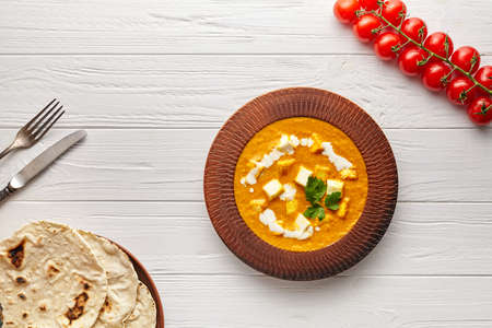 Shahi paneer Indian rustic vegetarian masala gravy meal with vegetables and white sauce Stockfoto