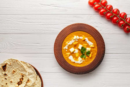 Shahi paneer traditional Indian vegetarian masala gravy with vegetables and butter paneer cheese on white