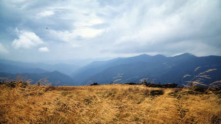 Beautiful mountain hills scenic travel view, autumn rural landscape.