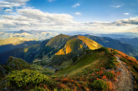Hiking path in mountain peaks and hills panorama outdoor view Archivio Fotografico