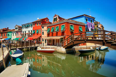 Burano lagoon famous traditional vivid colorful houses vibrant colors island tourism landmark cityscape Archivio Fotografico