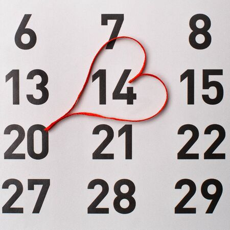 14th: 14Th of February calendar reminder with a red satin heart.