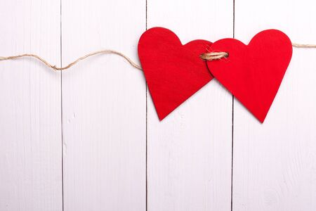tied: Two red hearts tied together Stock Photo