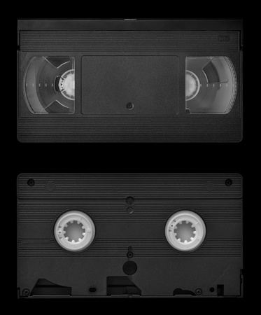 video cassette tape: VHS video cassette both sides isolated on black Stock Photo