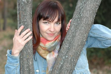 face in tree bark: Girl between trees Stock Photo