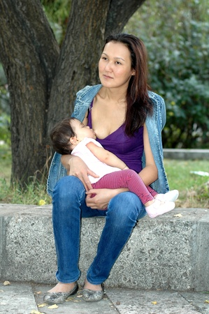 The Asian women with baby Stock Photo - 10897919