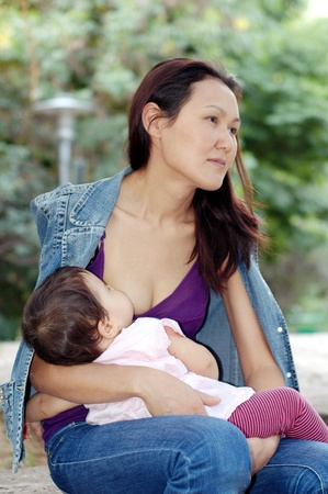 mongolian: The Asian women with baby Stock Photo