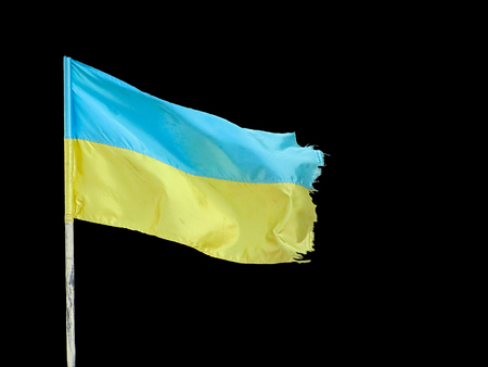 ukrainian flag, waving on blowing wind, isolated on black