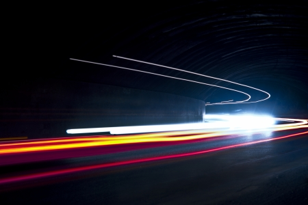 Car light trails  Art image   Long exposure photo taken in a tunnel Stock Photo