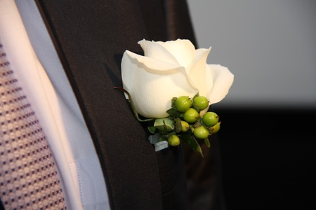 wedding boutonniere on suit of groom photo