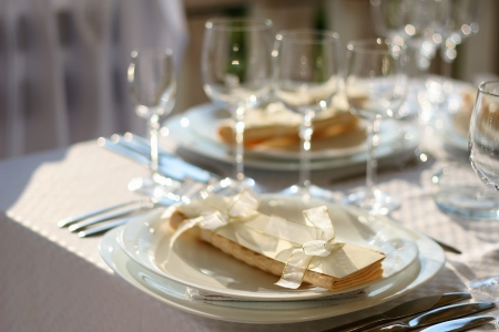 Fancy table set for a wedding dinner. Very shallow Focus