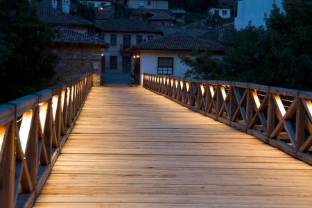 patriarchal: Evening scene in the old town . Night view of the Patriarchal Bridge in Veliko Tarnovo , Bulgaria