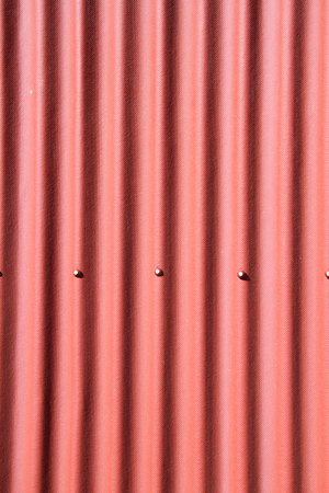 Red corrugated metal as a background image photo