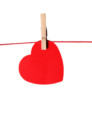 red paper heart hanging, isolated on white photo