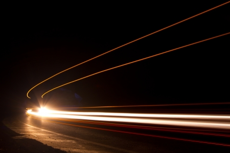 Car light trails. Art image . Long exposure photo taken in a tunnel Stock Photo