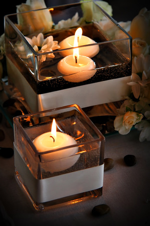 Floating candles in water Stock Photo