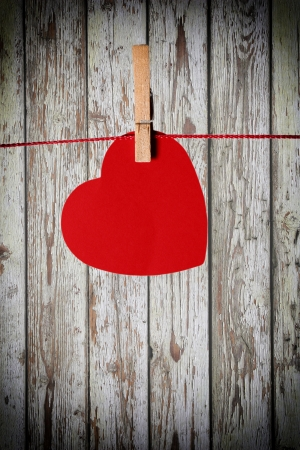 red paper heart hanging photo