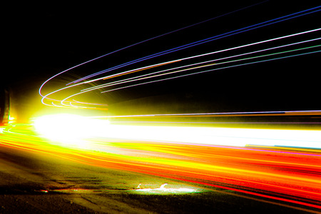 Car light trails. Art image . Long exposure photo taken in a tunne Stock Photo