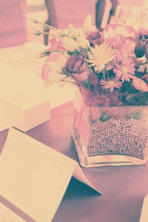 arrangement of a bouquet of purple flowers on purple\ tablecloth