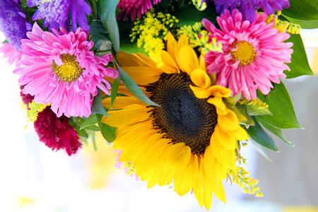 arrangement of summer flowers. sunflowers and aster