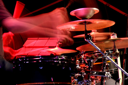 The drummer in action. A photo close up process play on a musical instrument Stock Photo