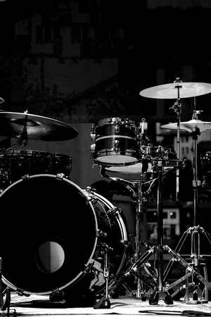 Drum Set with some cymbals on stage before a live Concert. photo
