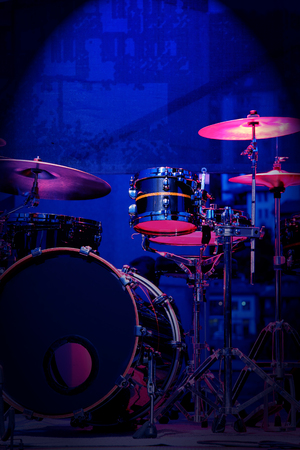 refelction: Drum Set with some cymbals on stage before a live Concert.