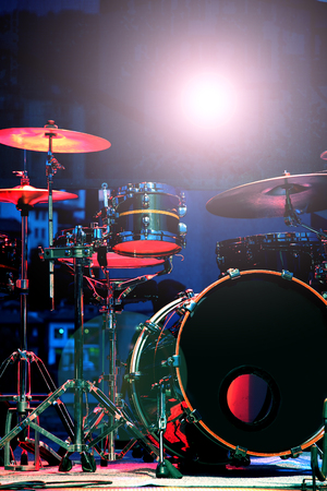 Drum Set with some cymbals on stage before a live Concert.