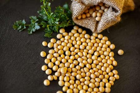 Whole grains raw soybean on dark background