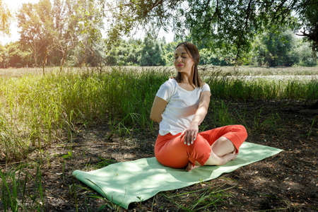 Yoga lifestyle - woman meditation in the nature  Stock Photo