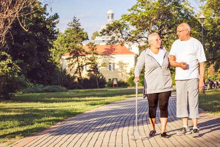 Happy Family - Smiling elderly couple walking through the park Stock Photo