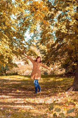 Enjoying in Autumn-– Young redhead girl in nature 스톡 콘텐츠