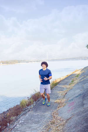 sporty man jogging and running outdoors in nature 免版税图像