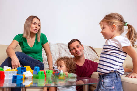 Family time - Young parent and children playing with blocks toys Zdjęcie Seryjne