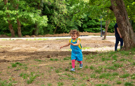 happy child girl running in nature