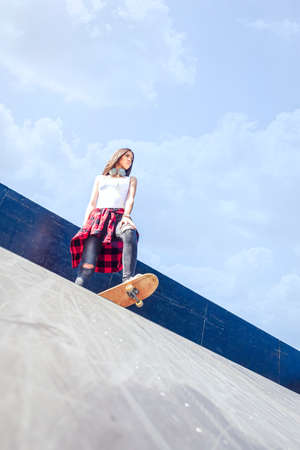 Young urban girl skateboarder