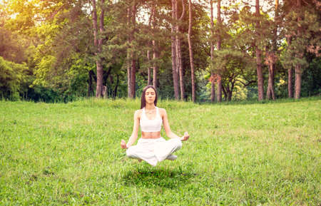 yoga meditation levitation – young girl concentration in yoga exercise