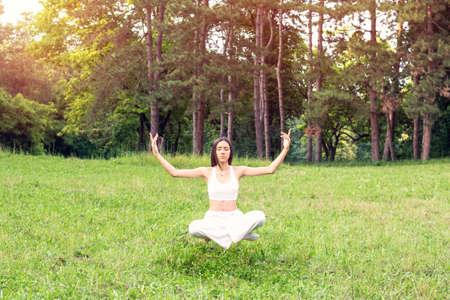Young girl in yoga meditation levitation