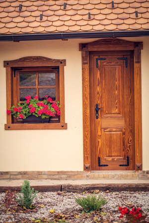 brown wooden window with flowers and wooden doors background