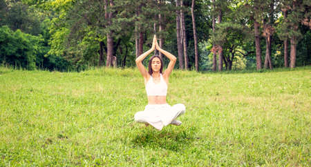 young girl levitating in yoga position, meditation outdoor