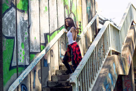 Young girl woman holding skateboard Outdoors, urban lifestyle.