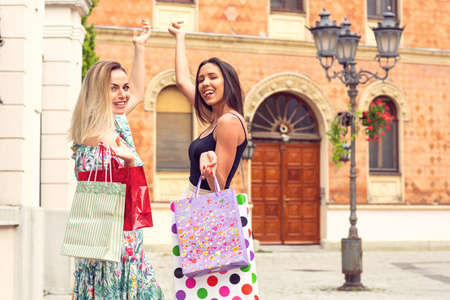 Shopping fun. - Happy girls shopping. bags, walking, holidays, gift Stockfoto