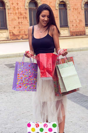 Shopping with a smile. Happy women holding a shopping bag.