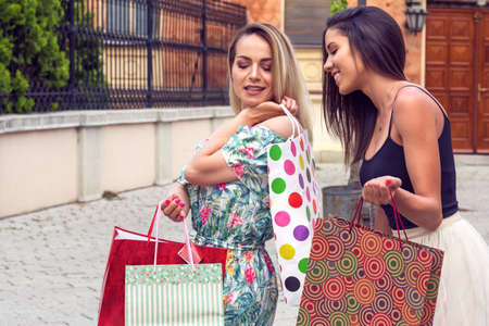 Shopping with a smile. Shopping fun.  Shopping and perfect mood. Beautiful smiling woman with shopping bags Stockfoto
