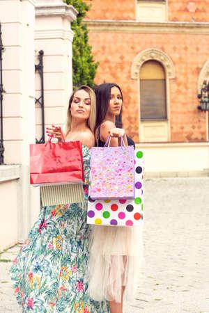 Shopping time - Two young women in shopping