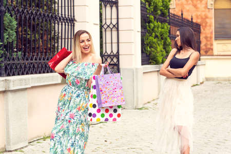 Jealous young girls shopping and arguing